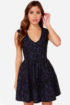 """After you try on the Hazel Never Give You Up Navy Blue Lace Dress, you'll want to keep it close forever! Gorgeous black lace swirls over a knit navy blue backing while a V neckline sits snug on a fitted sleeveless bodice. Light gatherings at the waistline introduce a flared skirt for that perfect skater dress fit. Exposed silver zipper on back. Dress is fully lined. Model is 5'7"""" and wearing a size small. Self: 96% Polyester, 4% Spandex. Lining: 100% Polyester. Dry Clean Only. Imported."""