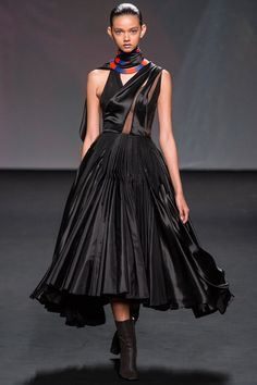 Dior F13 - We will see a celeb in this fo sho.  Loving all the red and black Im seeing!