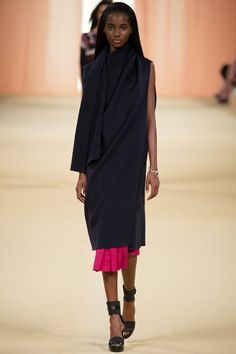 Hermes PFW SS15 - a gorgeous floaty and elegant collection for the last show of the season and also for Christophe Lemaire at Hermes with the idea of 'wrapping' seen throughout - we loved this midi dress with a pop of pink...x
