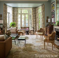 This elegant living room has a bay of French doors that let in the light and a welcome garden view. - Photo: John Bessler