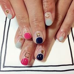 Those charms are really cool, but those large dots of color that aren't quite half-moons could become your new go-to design. | 14 New Nail Art Ideas To Shake Up Your Mani