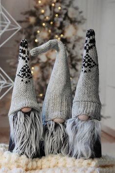 Nordic Gnome in fun and festive knitted winter themed hats This listing is for one Large Size Gnome 16 ( bend hat about 13 ) All sweater hat gnomes are one of the kinds and can not be duplicated. You will get the one in the first two pictures. This gnome has a blacke heavy weight cotton