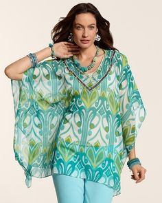 "The light-as-air poncho sprinkled at the neckline. The detail finish: sequins, pretend pearls, and barrel beads.   Pull-on styling with flowy poncho sleeves.  Semi-sheer silhouette is ideal for layering.  Length: 26"" to 29"".  100% polyester.  Hand wash. Imported."