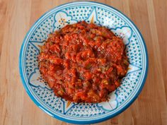 Recipe for Moroccan Matbucha- tomato salad with roasted peppers, jalapeno, garlic, olive oil and paprika. Salade Cuite, Matboucha, Kosher, Vegan.