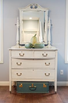 Classic white antique dresser. I  am loving green and white for fall colours this year. Decorate with fresh harvest vegetables for an easy and timeless look. Plus you can eat them after! Lee.Marie Antiqued Furniture