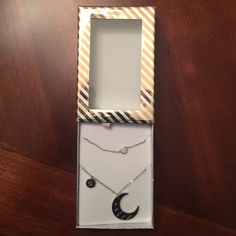 NWT's 2 silver tone necklaces. NWT's 2 silver tone necklaces. 1 necklace has a charm that says Love You with a crescent moon that says to the moon and back. The second necklace has an attached solid small heart. Jewelry Necklaces