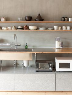 Two long plywood shelves line a concrete wall above an industrial looking Ted countertop in a Tokyo apartment by Naruse Inokuma Architects. <-- cement and wood Wabi Sabi, New Kitchen, Kitchen Dining, Minimal Kitchen, Minimalistic Kitchen, Kitchen Ideas, Tokyo Kitchen, Basic Kitchen, Kitchen Decor