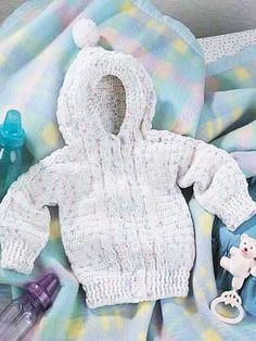 """Cable Sweater - 8 adorable bunny buttons & a sassy pompom accentuate this warm cable sweater. Child sizes: 6 mths-1 yr (2-4-6) Chest: 19 (21-23-25)"""" Underarm sleeve to wrist: 7-1/2 (9,10-1/2,12)"""" Sleeve width: 7-1/2 (8,9,9-1/2)"""" Back neck to bottom: 11-1/2 (12-1/2,14,17- 1/2)"""" Hood length: 7-1/2 (8,9,9-1/2)"""" Skill level: Intermediate  Designed by Agnes Russell  free pdf from free-crochet.com"""