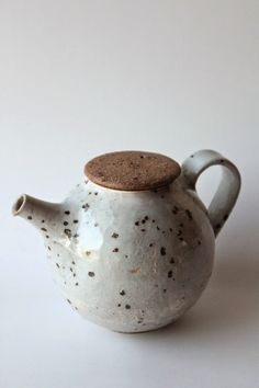 Stunning glaze with iron (?) Spots.  Leaving the lid unglazed creates a beautiful contrast and highlights the texture of the clay
