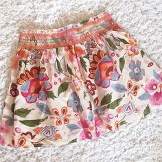 Floral Skirt Lightweight skirt with vibrant, colorful print. Waist measures 15 inches across. Total length is 17 inches. Waistband is stretchy. 100% Cotton. Never worn. Excellent condition. Purchased at Belk.  Reasonable offers welcome via the 'make offer' feature. I no longer negotiate prices in the comments. Bundle discount is listed above.  Skirts