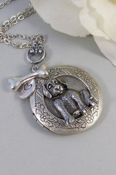 This lovely sweet little antiqued silver puppy locket is absolutley adorable, and has such great detail. You can see the puppies eyes, nose,