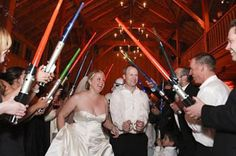 ok... so I saw this type of thing on Four Weddings TLC... decided to show Jo...  hmmm maybe I shouldn't have lol now I told him we can enter the reception under some lightsabers! I guess the groom should have a say in the wedding too... :S LOL!