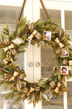 I took a simple wreath and tied milk bone dog biscuits with stripped ribbon. To celebrate my pups I made miniature gold framed pictures of my pack of babies. You can do the same for a family wreath –but skip the dog biscuits and tie on candies….
