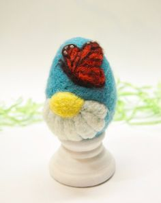 Theres just something about the shape of an egg. I kind of wish it was perpetually pre- Easter because I am having so much fun sculpting them!  This felted egg is made entirely of hand dyed wool, sculpted with a felting needle. Each is approximately 2.5 inches tall and 1.75 inches wide (just slightly larger than a large chicken egg) It is felted quite firmly, with just a touch of squeeze-ability. There is something about them that children just love: arranging, sorting, putting them in…