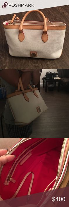 White Dooney & Bourke Bag Tan trim, shoulder strap is adjustable and removable.    ⚠️ I only quote bundles. ⚠️ Use the 'Offer' tool for single items. ⚠️ No Trades. ⚠️ No holds. ⚠️ No soliciting. Dooney & Bourke Bags Mini Bags