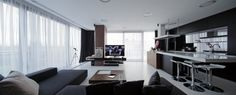 AC Apartment Interior by Square ONE.  Black, white and brown, nice sheer curtians, wrap around windows.