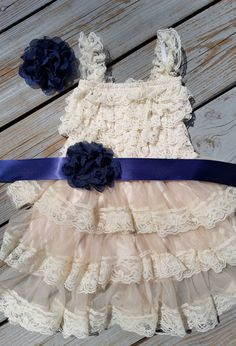 Or Visit Here: https://www.facebook.com/thedaintydaisynj      How adorable is this rustic lace pettidress! With navy blue lace flowers! Includes