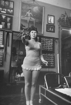 Opera singer Roberta Peters working with an elastic gadget that sets up muscular tensions all over the body. Photo taken in Joesph Pilates' studio in NY, feb 1951.