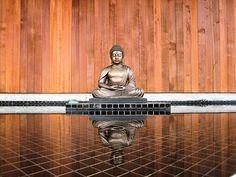 Buddha by reflecting pool at Spirit Rock meditation center