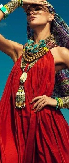 Gypsetter style. Huge chunky jewels , soft flowy fabrics and fabulous head wrap.