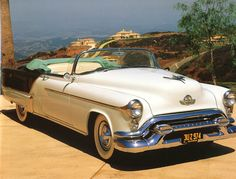 1953 Olds Fiesta Convertible  Mine was all white with red leather interior. Gianormous but I loved it.