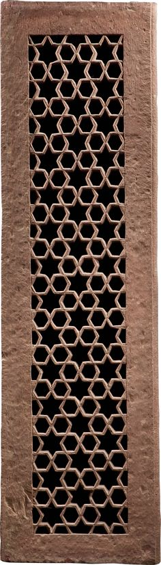 STARS AND HEXAGONS JALI - India (Mughal), 17th century - A finely carved double-sided red sandstone jali screen, the mottled red sandstone carved with an interlocking design of six-pointed stars each surrounded by six hexagons that connect to the adjacent stars to form a delicate geometric lattice.