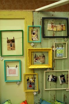 painted frames with wire or twine and decorative paper clips for the photos holders