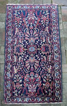 Blue Sarouk. 2 ft 1 inches by 4 ft 0 inches.