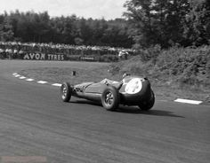 """1958 Kentish """"100"""", Brands Hatch : Graham Hill in Lotus-Climax 16 during the 1st heat. (ph: © J. Ross)"""