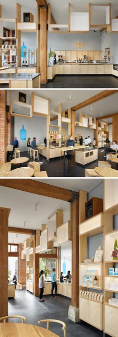 The stainless steel and birch plywood bar compliments the concrete flooring, original brickwork, wood accents, and exposed beams throughout this modern cafe.