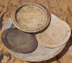 Group of three early treen plates resting in a large treen charger. google.com