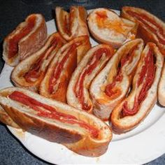 1 pound refrigerated bread dough  1 (8 ounce) package sliced pepperoni  1 (16 ounce) package shredded mozzarella cheese  2 tablespoons olive oil