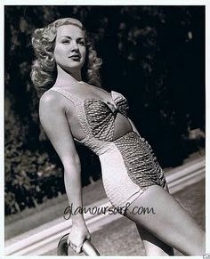 14c871e94fddf Betty Grable in a couple of fashionable swimsuits. Love the cut out on the  midriff in the second picture.