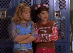 Every Awkward Outfit From Lizzie McGuire, From Clashing Prints To Fuzzy Hair Accessories