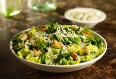 STONEFIRE Grill's Caesar Salad made fresh with Romaine, Croutons, Parmesan Cheese and our tossed with our Creamy Caesar Dressing.