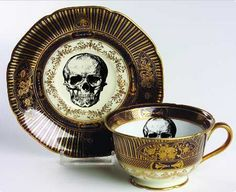 GORGEOUS BLACK AND GOLD SKULL CUP AND SAUCER SET  This stunning foodsafe, durable cup and saucer set will be infused with the image of a hand-designed skull. The border is a scrolled gold with a solid black color on the cup and saucer. Matching teapot/sugar/creamer available. This is the perfect cup for your Halloween tea party or off-the-wall wedding set, you will enjoy it for years to come. The cup and saucer set is food safe, I would recommend hand washing to make sure the gold stays like…