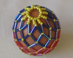 Photo Tutorial A couple of years ago I found an excellent tutorial on how to make a beaded egg shell - and I made this one. I've lost the ...