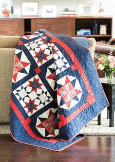 High contrast between the light and dark fabrics in Christy Bowman's design results in a stunning Quilt of Valor. The two different sized star blocks make the piecing more fun.