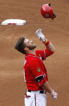 Bryce Harper #34 of the Washington Nationals reacts after flying out against the Miami Marlins to end the fourth inning.
