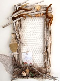 Driftwood Memo Board - This beach memo board is just awesome. Original source is no longer available, but looks like it's built with four flat driftwood planks. Chicken wire is stapled to the back. Then decorate to your heart's content.