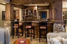 Family Room - traditional - family room - minneapolis - Stonewood, LLC; kitchen bar solid cedar wood post cabinets above