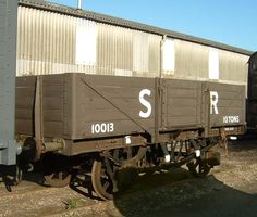 """SR 5 Plank Open Goods Wagon No 10013 - These wagons were classed as """"rebuilds"""" because, despite the body and underframe being new, the wheelsets, axleboxes and springs were recovered from ex-LSWR vehicles. The frames were non-standard to accommodate the wider axle journal centres of the LSWR wheelsets."""