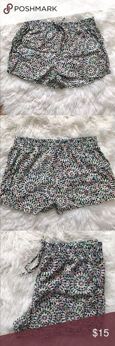 Multicolored Drawstring Shorts Cute multicolored shorts by Joe Benbasset. Elastic at the waistband with drawstring. Has pockets. Versatile design - can be worn as sleep shorts, an outfit for the beach, or you can dress it up with a dressy white top with some brown sandals and gold statement jewelry. #4191710 joe Benabasset Shorts