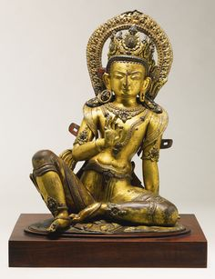 A Gilt Copper Repoussé Figure Depicting Indra Height: 17 in. (43.2 cm) Nepal, circa 16th century