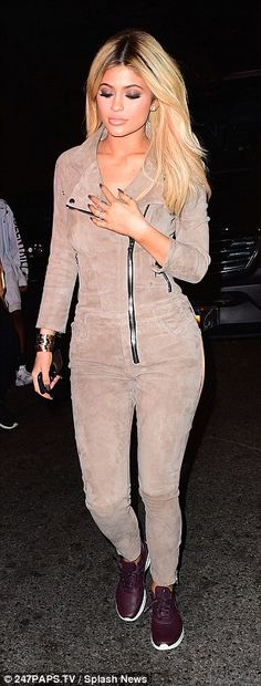 That's better: For their dinner, Kylie opted for something a little more comfortable ditching her dress and heels for a tan velour tracksuit