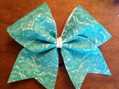 I wish my team would get bows like these!! They would look so pretty with our uniforms