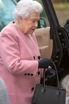 Queen Elizabeth II looked radiant as she arrived in a sugary pink coat, which she accessorized with a simple black tote.