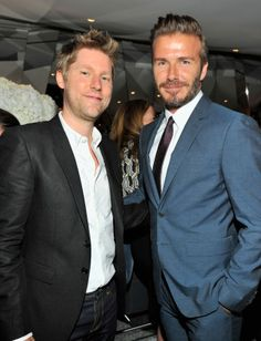 Christopher Bailey and David Beckham celebrate Victoria Beckham's spring collection.