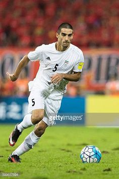 Milad Mohammadi of Iran drives the ball during the 2018 Russia World Cup Asia Qualifiers match between China and Iran at Shenyang Olympic Stadium on...