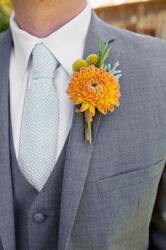 Groom in gray three-piece suit, blue seersucker tie and orange dahlia boutonniere {Heather Scharf Photography}